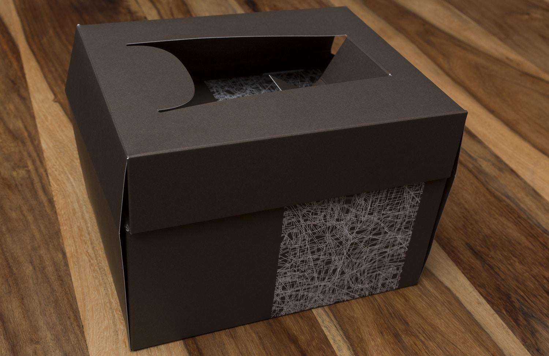 Seitenansicht einer Schachtel der Druckerei Rapp-Druck GmbH